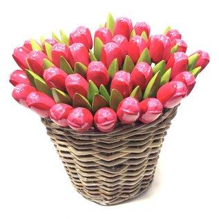 Pink wooden tulips in a wicker basket