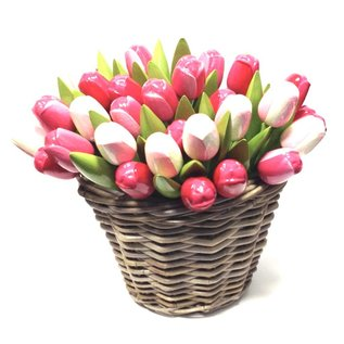 Wooden tulips in a wicker basket in mixed rose colors