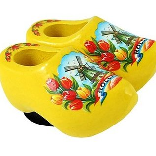 clogs with a magnet on its back in the color yellow