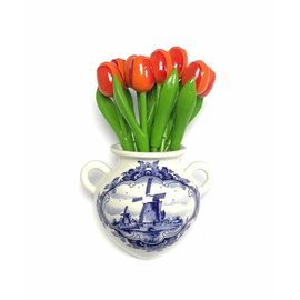 Orange wooden tulips in a Delft blue wall vase