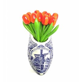 Orange wooden tulips in a Delft blue clog