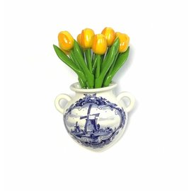 Yellow wooden tulips in a Delft blue wall vase