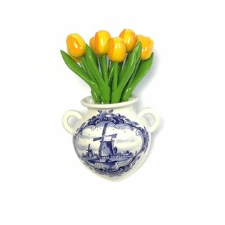 small yellow wooden tulips in a Delft blue wall vase