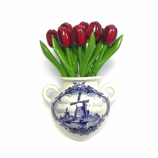 small red wooden tulips in a Delft blue wall vase