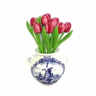 Red - white wooden tulips in a Delft blue wall vase