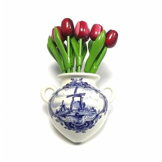 small wooden tulips in mixed colors red in a Delft blue wall vase
