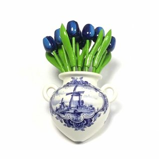 Blue wooden tulips in a Delft blue wall vase