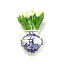 White wooden tulips in a Delft blue wall vase