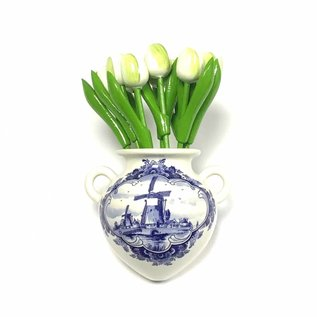 small white wooden tulips in a Delft blue wall vase