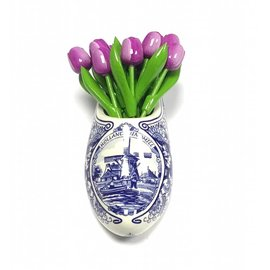 Purple wooden tulips in a Delft blue clog