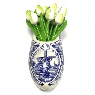 small wooden tulips in white in a Delft blue wall vase