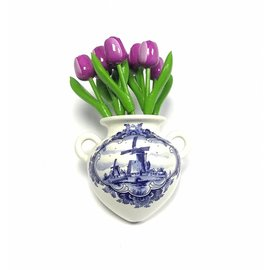 Purple wooden tulips in a Delft blue wall vase