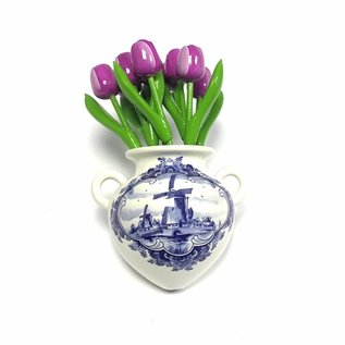 small purple wooden tulips  in a Delft blue wall vase
