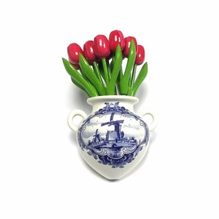 Pink wooden tulips in a Delft blue wall vase