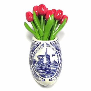 Pink wooden tulips in a Delft blue clog