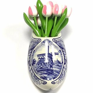 White-pink wooden tulips in a Delft blue clog