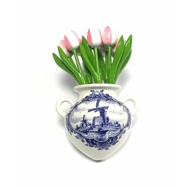 White-pink wooden tulips in a Delft blue wall vase