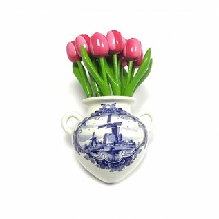Pink - white wooden tulips in a Delft blue wall vase