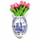 small wooden tulips in rose - white in a Delft blue wall vase