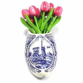 Roze/witte houten tulpen in een Delfts blauwe klomp