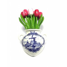 Wooden tulips in mixed pink colors in a Delft blue wall vase