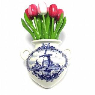 Kleine Holztulpen in gemischten Farben Rosa in einer Delfter blauen Wandvase