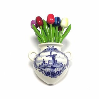 small wooden tulips in mixed colors in a Delft blue wall vase