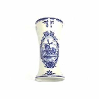 Small dark purple wooden tulips in a Delft blue vase