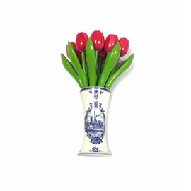 small wooden tulips in rosa in a Delft blue vase