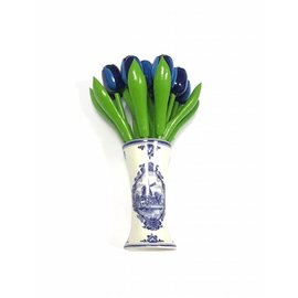 small wooden tulips in blue in a Delft blue vase
