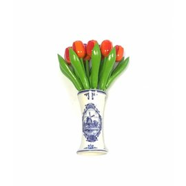 small wooden tulips in orange in a Delft blue vase