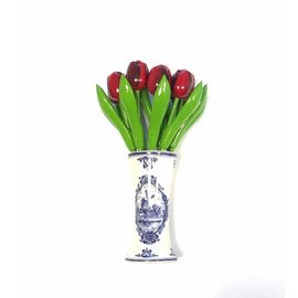 Red wooden tulips in a Delft blue vase