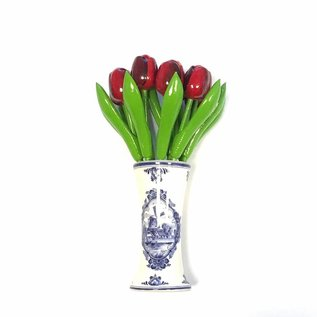 wooden tulips in red in a Delft blue vase