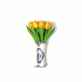 small wooden tulips in yellow in a Delft blue vase