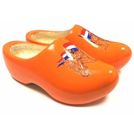 Orange wooden shoes with lions