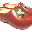 wooden shoes own dog