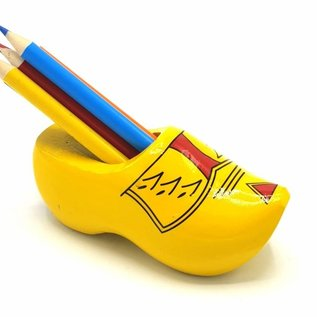 Clog sharpener yellow with stripes with colored pencils.