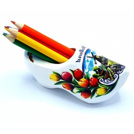 white clog point sharpener with colored pencils
