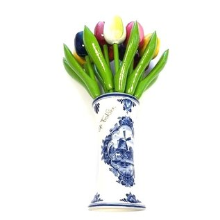 small wooden tulips in a Delft blue vase with logo