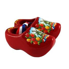Souvenirs woodenshoes red with tulips and a windmill.