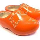 Orange wooden shoes with piping