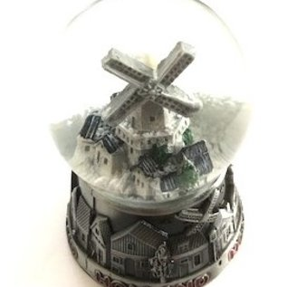 large metal water globe with a village with a mill