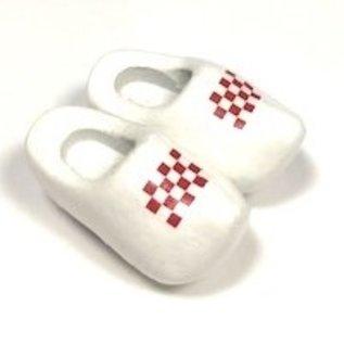 Souvenir clogs on a magnet with flag