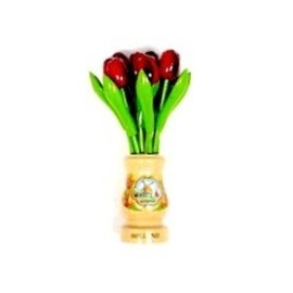 red wooden tulips in a transparent wooden vase