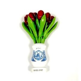 Red wooden tulips in a white wooden vase