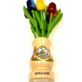 mixed wooden tulips in a transparent wooden vase