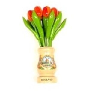 Orange wooden tulips in a transparent wooden vase