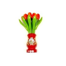 Orange wooden tulips in a red wooden vase
