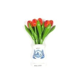 Orange wooden tulips in a white wooden vase
