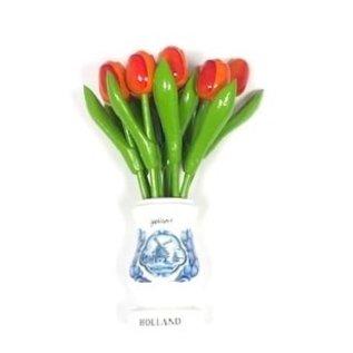 Orange wooden tulips in a white wooden vase